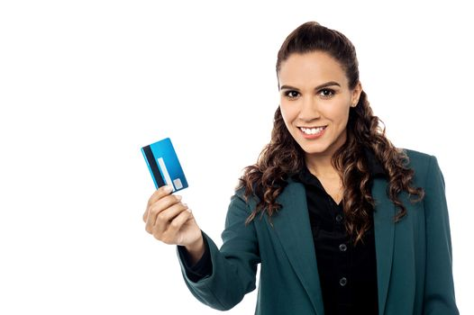 Businesswoman displaying her cash card