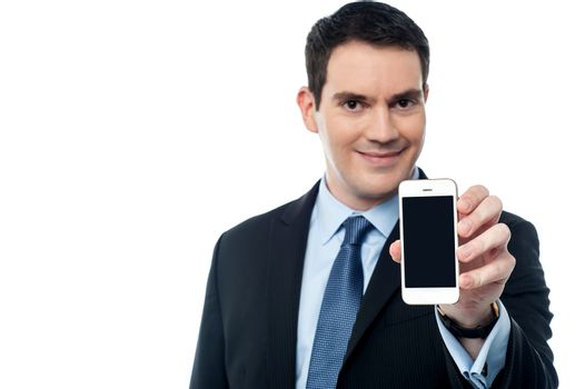 Businessman showing a mobile phone