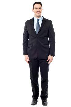 Handsome entrepreneur posing, isolated over white