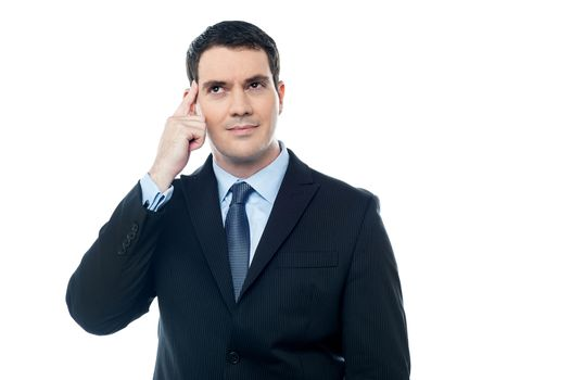 Confident Businessman point finger to head