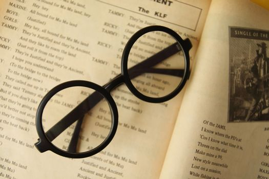 eyeglasses on the open book.