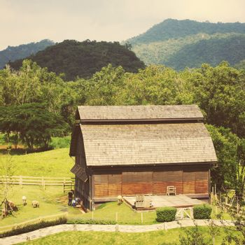 Old storehouse in countryside area with animal farm