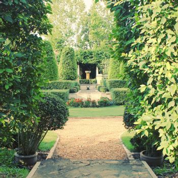 Beautiful classic garden with retro filter effect