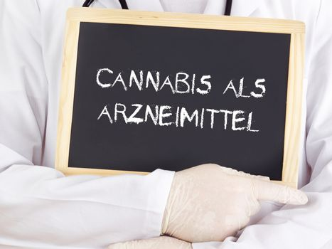 Doctor shows information on blackboard: medical cannabis in german