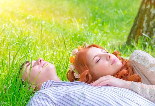 Young lovers resting outdoors