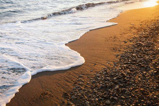 Wave on a beach at dawn