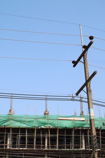 electricity post and underconstruction building