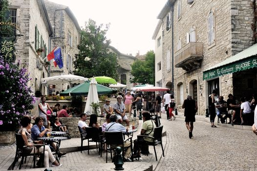 Summer terraces breweries are installed in the streets of the old village of Vezenobres in the French department of Gard