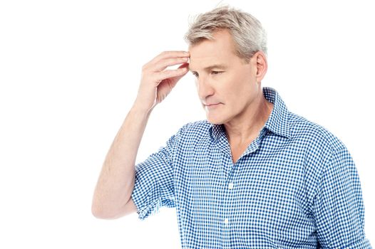 Stressed man suffering from headache