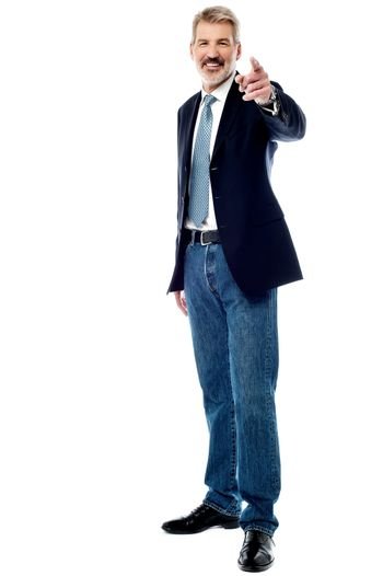Senior businessman pointing to front
