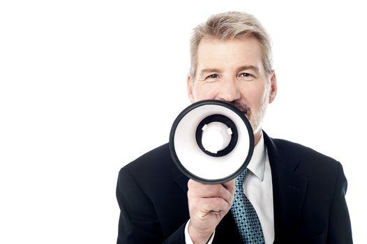 Businessman posing with bullhorn