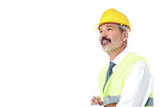 Confident architect with jacket and hard hat