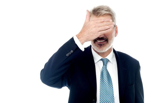 Businessman making the see no gesture