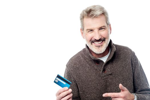 Smiling aged man showing his debit card