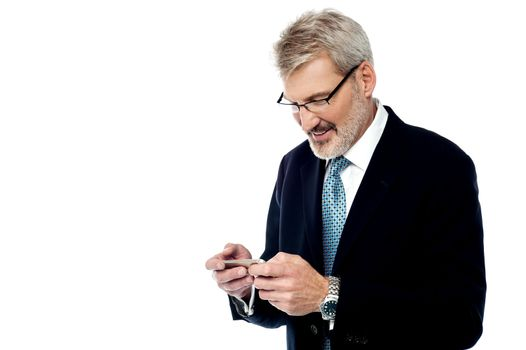 Senior businessman reading a text message