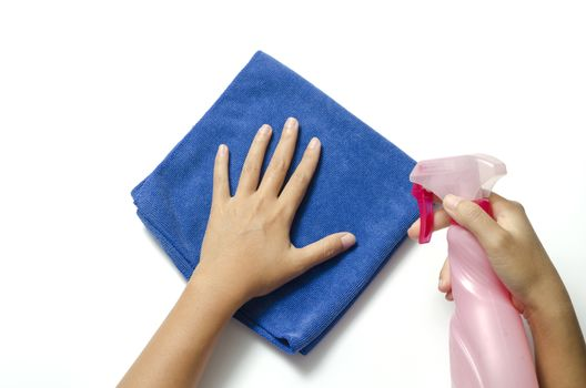 hand cleaning with spray bottle and blue rag