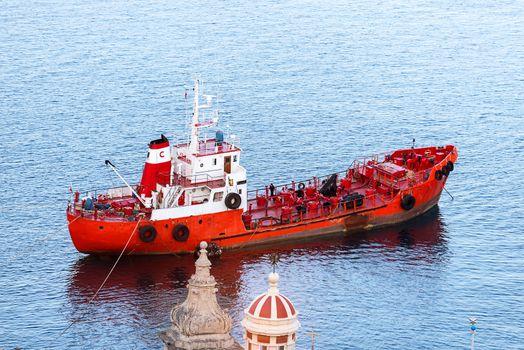 Red ship neat Malta coast
