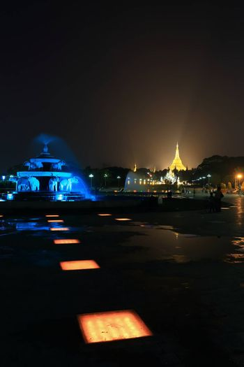 fountain with colorful illuminations at night near the Shwedagon Pagoda