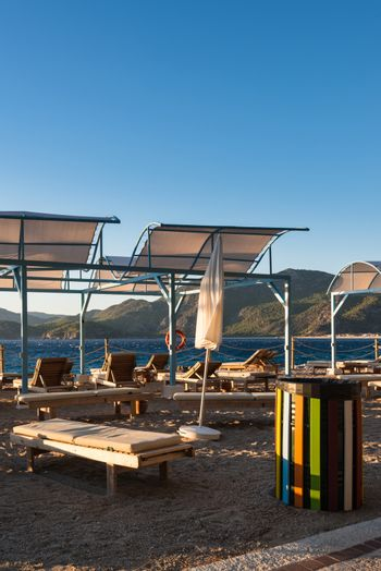 Sun loungers with umbrellas on the beach