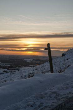 Scenic snowy view from Ramshaw Rocks, Peak District, looking towards Leek, Staffordshire