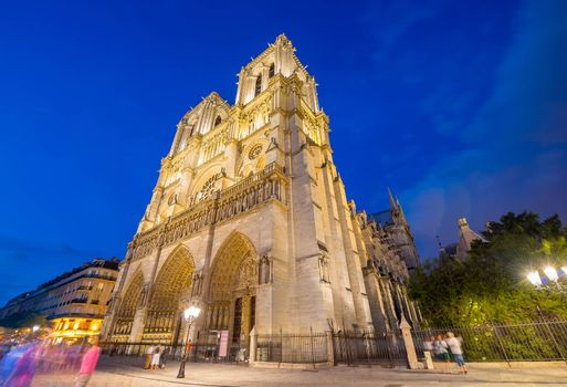 Stunning view of Notre Dame cathedral at dusk, Paris - France.