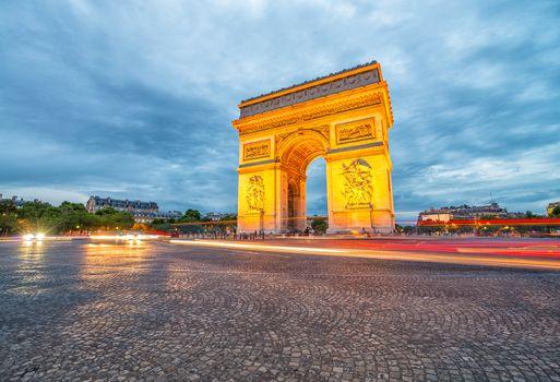 Triumph Arc with city traffic at night, Paris.