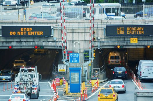NEW YORK CITY - MAY 10, 2014: Entrance of Queens Midtown Tunnel with city traffic. Designed by Ole Singstad, it was opened to traffic on November 15, 1940.