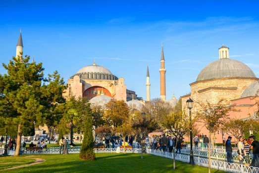 ISTANBUL, TURKEY - SEPTEMBER 14, 2014: Tourists walk in Sultanahmet Square. More than 10 million people visit the city every year.