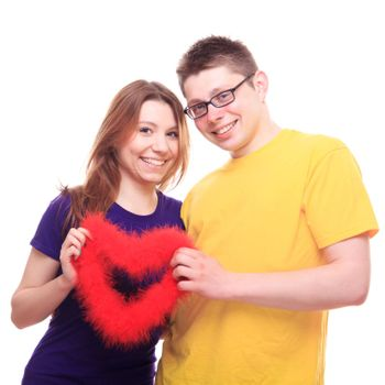 Young people in love holding heart - studio shoot