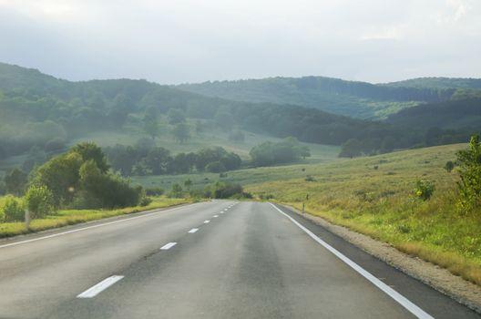 Empty Evening Road Over Nice Natural Landscape