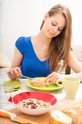 A young adult woman preparing a european style breakfast.