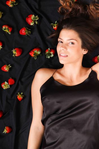 A young adult american woman dreaming of strawberries.