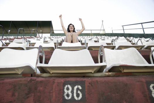 A vintage style cheering girl in a sports stadium.