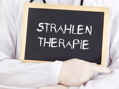 Doctor shows information: radiation therapy in german language
