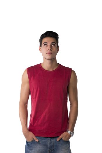 Attractive young man in red sleeveless shirt and jeans, looking up