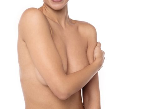 Naked young woman isolated over white