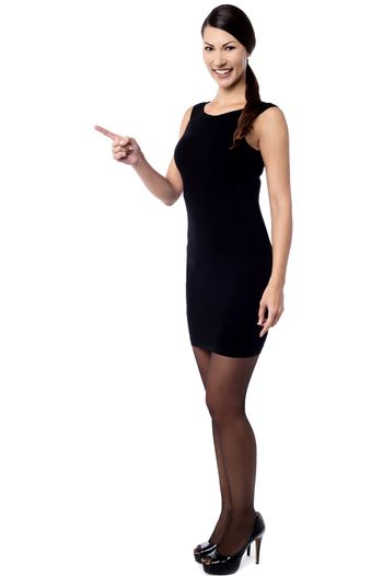 Trendy woman pointing a copy space