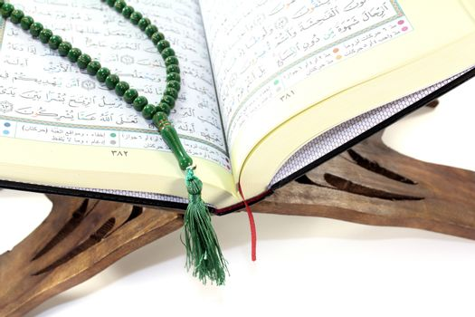 stand with Quran and rosary