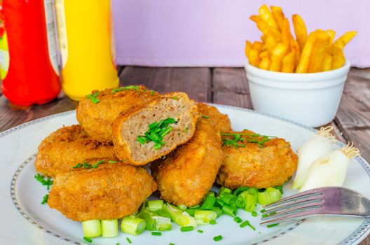 Breaded meatball with coriander and garlic