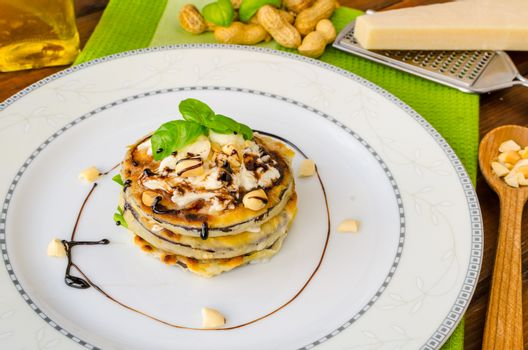 Grilled eggplant with feta cheese,parmesan basil, nuts