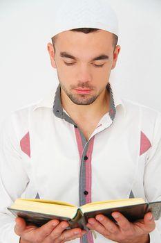 Young man reading the Holy Koran
