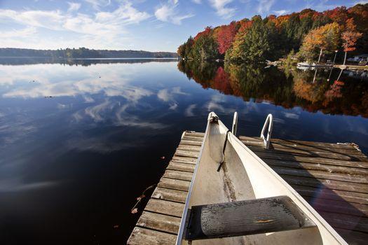 Lake in Autumn Algonquin Muskoka Ontario colors dock canoe