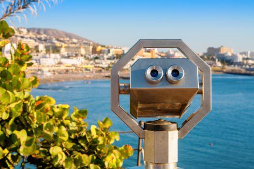 Binoculars overlooking Playa Fanabe. Costa Adeje, Tenerife, Canary Islands, Spain