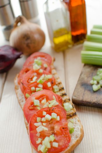 Grilled baguette with grilled tomatoes