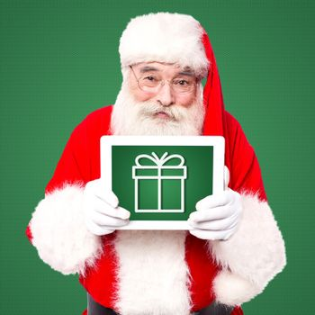 Santa displaying his tablet pc gift for lucky winner