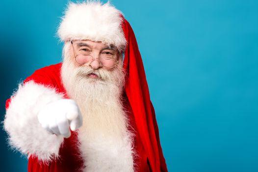 Happy santa claus pointing at you