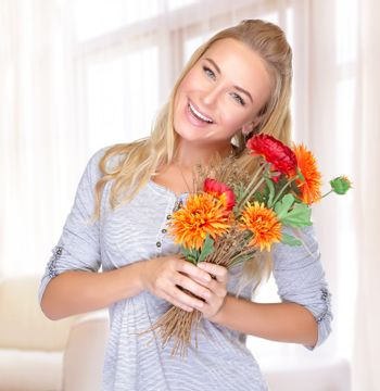 Cheerful female with flowers