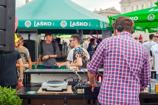 TRIESTE, ITALY - OCTOBER, 12: Dj playing music in the street during the 46 th Barcolana on October 12, 2014