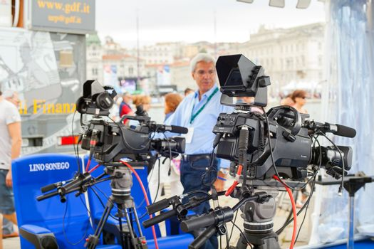 TRIESTE, ITALY - OCTOBER, 12: The crew of the RAI, Radiotelevisione italiana, preparing the interview set during the 46 th Barcolana on October 12, 2014