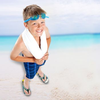 Aerial view of boy in swimming goggles on beach background